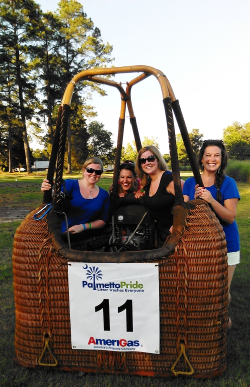Team Clark Harbold girls in the hot air balloon basket.